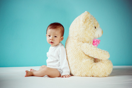 pink teddy bear: Baby girl with his teddy bear new family and love concept.