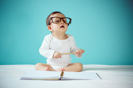 specs: Little baby with Glasses Stock Photo