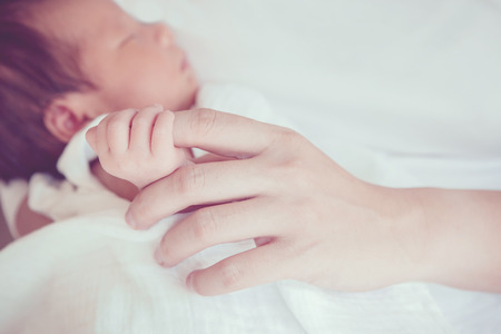 Soft focus and blurry of Baby Hands vintage style color effect Archivio Fotografico