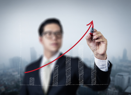 red hand: Businessman hand writing graph of growth, new business concept, studio shot Stock Photo