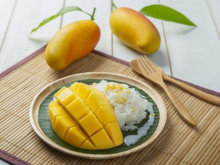 mango leaves: Dessert sweet sticky rice with mango coconut milk Stock Photo