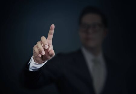 blank screen: Businessman pushing a transparent screen. Business technology, internet and networking concept. Stock Photo