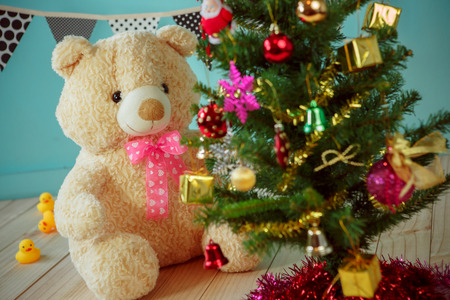 room decoration: Bear with christmas tree on green background Stock Photo