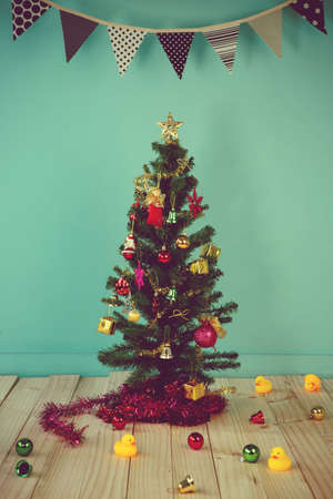 room decoration: Christmas with decorated item hanging in a tree