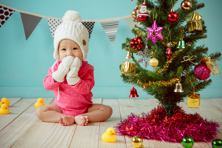 new born baby girl: Baby with christmas background