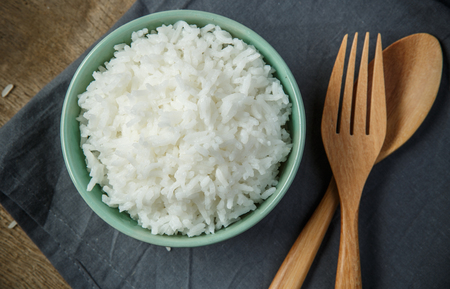 white rice: Organic White Rice with wooden spoon  fork - soft focus