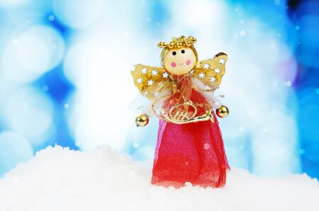 pink christmas: Angel and christmas decoration on abstract background and snowflakes - selective focus shot