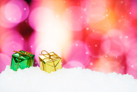focus shot: Gift Box and christmas decoration on abstract background and snowflakes - selective focus shot