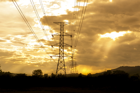 color distribution: Energy Distribution Network - Electricity Pylons against Orange and Yellow Sunset - Vibrant color effect