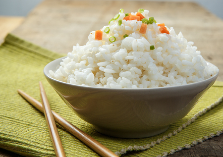Steamed rice close-up with chopsticks on a fabric mat Stock Photo