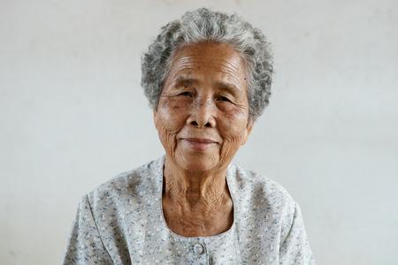underdeveloped: Smilling of happy Asian elderly senior on white background