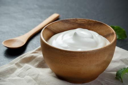 Greek yogurt on black stone background