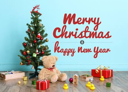christmas tree flag and christmas decorations with toy teddy bear on blue background with