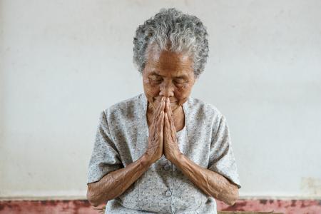 Pray of senior asian woman Stock Photo