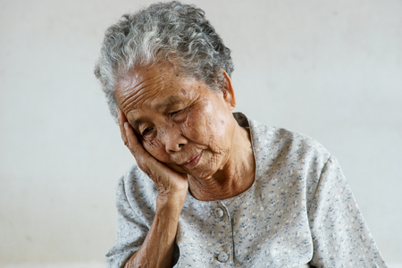 underdeveloped: Senior asian woman was headache
