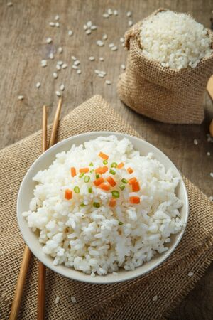 Steamed rice close-up with chopsticks on burlap Stock Photo
