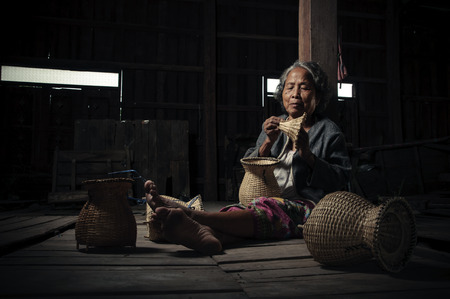 underdeveloped: Asian grandmother fisherman with the net bamboo Stock Photo