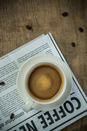 crema: Coffee cup and Newspaper for business