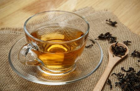 Vintage tea and leaves tea on sacking background Stock Photo