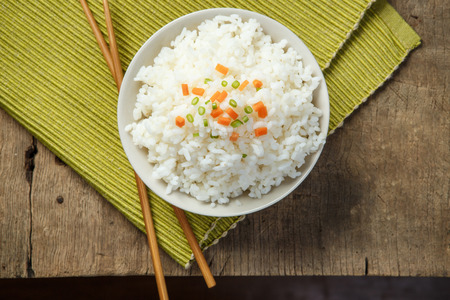 thialand: Steamed rice close-up with chopsticks on a fabric mat Stock Photo