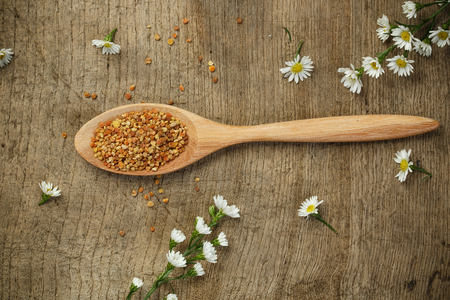 antimicrobial: Bee pollen with wooden spoon and flower