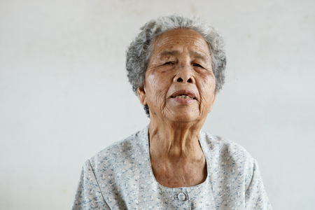 underdeveloped: Protrait of senior asian woman on white background