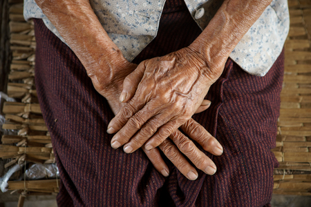 clasp feet: Hold ones hands of Asian Grandmother