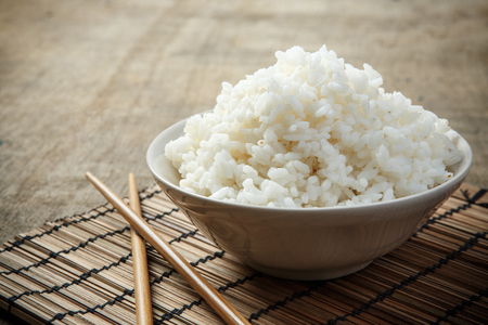jasmine rice: A bowl of rice on a bamboo mat