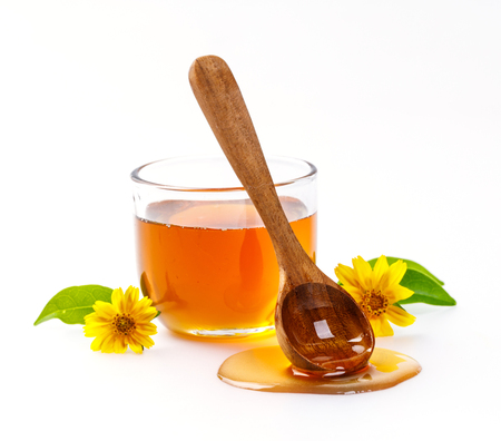 drizzler: Honey with jar and honey spoon and folwer isolated on white background