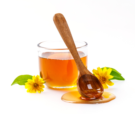 praiseworthy: Honey with jar and honey spoon and folwer isolated on white background