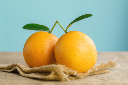 Oranges group freshly on a wooden table. Half of orange on the wooden table. Empty ready for your orange