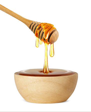 Honey dripping isolated on a white background, Dripped honey, Honey dipper Imagens - 119365187