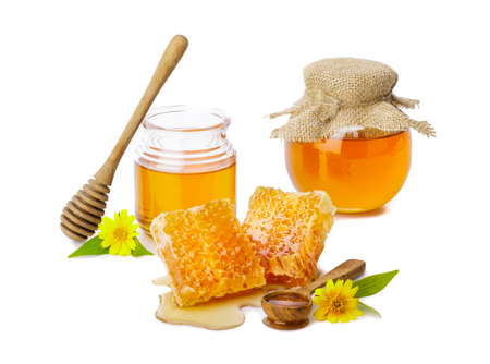 Honeycomb and honey bee in the jar with honey dipper isolate on white background, bee products by organic natural ingredients concept 写真素材
