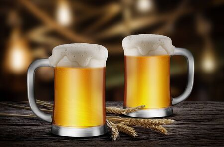 Two Glasses of Light Beer with wheat on the wooden table in the restaurant, with copy space for your text