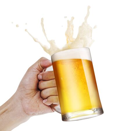 Hand holding a mug of light beer toasting with bubble froth splash isolate white background with copy space