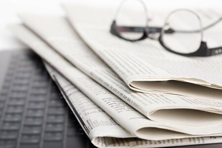 Mockup of Business Newspaper with glasses isolated on white background