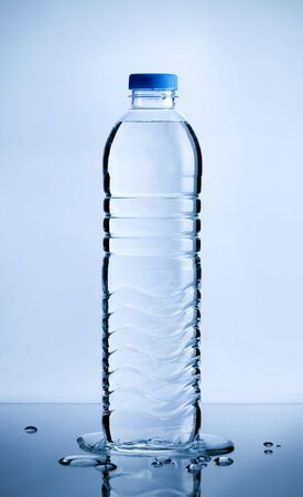 Plastic pure water bottle with water drops on table, Healthcare and beauty hydration concept
