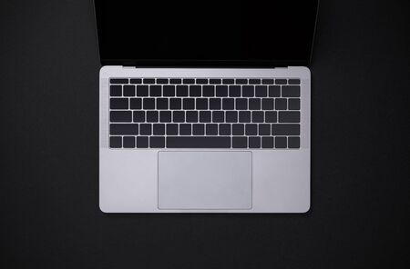 Top view workspace with notebook on black table overhead view with copy space, Workspace for new designer background Banco de Imagens