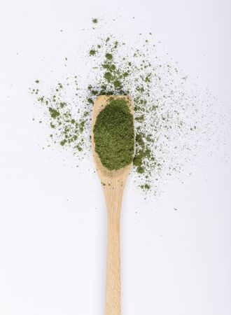 Matcha green tea powder in spoon isolated on white background creative flat lay, Organic product from the nature for healthy with traditional style