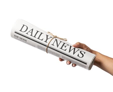 Hand holding Rolled Business Newspaper with the headline News isolated on white background, Daily Newspaper mock-up concept