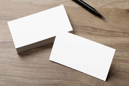 Minimal business card mockup on wooden desk Banco de Imagens