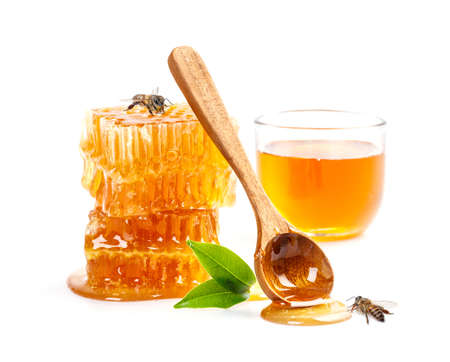 Honeycomb with bee and honey spoon isolate on white banner background, bee products by organic natural ingredients concept Stock Photo