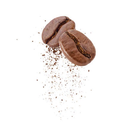 Flying whirl roasted coffee beans in the air with coffee powder studio shot isolated on white background, Healthy products by organic natural ingredients concept 免版税图像