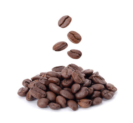 Flying whirl roasted coffee beans in the air studio shot isolated on white background, Healthy products by organic natural ingredients concept