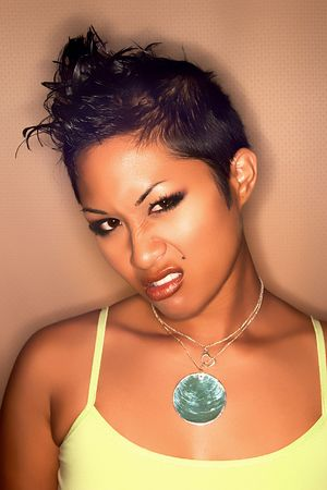 spiked hair: Headshot of pretty Asian glamour model with spiked hair showing attitude Stock Photo