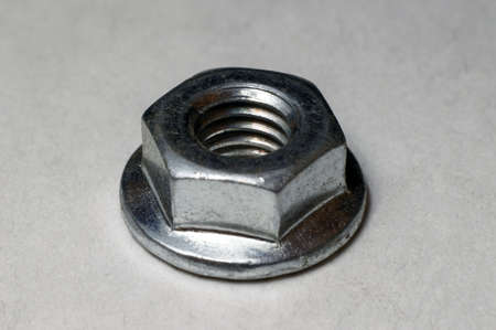 M6 metal nut with skirt on a white background close-up. 写真素材