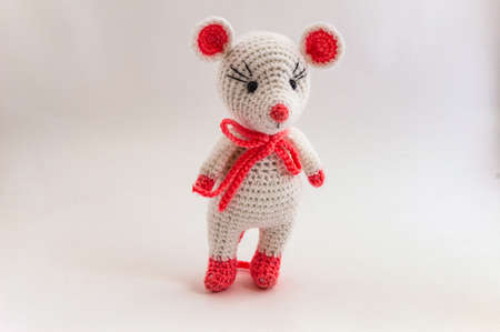 Mouse Amigurumi posing for a photographer standing on a white background.