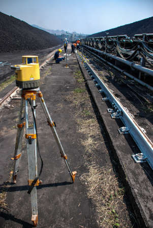 conveyor rail: the workers checked level of machine