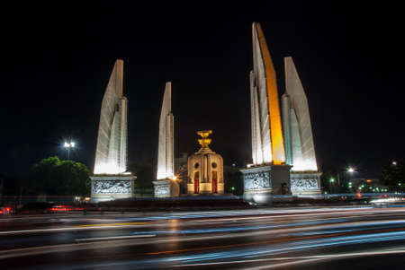 The democracy monument was taken during night by using slow speed shutter technique. The colour lines in this picture are automotive lighting  photo