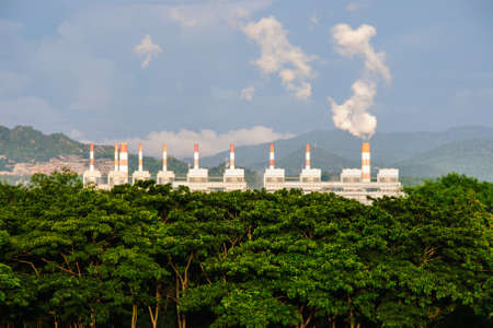Coal power plant with steam pouring out of the stack, Mae Moh Power Plant, Lampang, Thailand photo